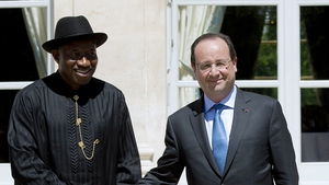 Francois Hollande pictured with Nigerian president Goodluck Jonathan ahead of a summit in Paris