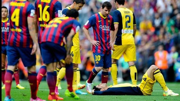 Diego Costa lies injured against Barcelona