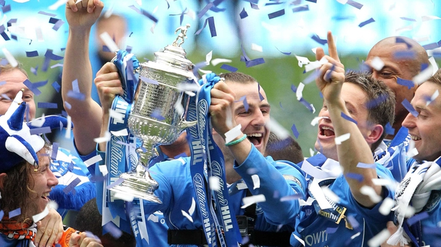 St Johnstone captain David Mackay lifts the prize