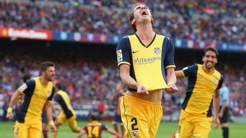 Diego Godin celebrates Atletico Madrid's equaliser at the Camp Nou, which sealed the La Liga title for the Atléti