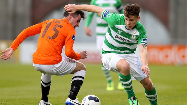 Luke Byrne goes past Graham Rusk as the Hoops moved to the top of the table
