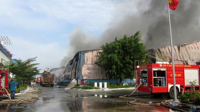 Smoke billows from a Taiwanese furniture factory in Binh Duong
