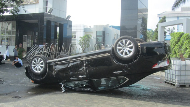 Photo taken on 14 May shows a damaged car at a Taiwanese furniture factory in Binh Duong as anti-China protesters set more than a dozen factories on fire