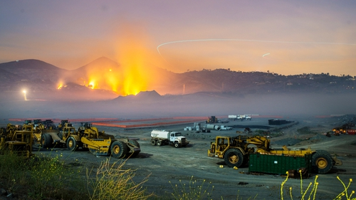 Longtime exposure shows smolderings remains of fires on the hillsides of San Marcos, San Diego county