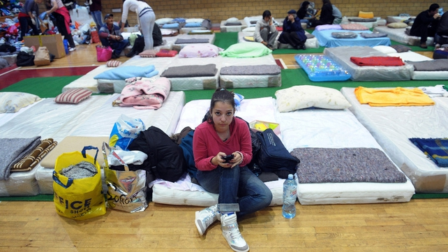 A girl sits on a mattress in centre for people evacuated from the flooded town of Obrenovac