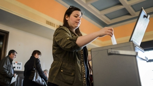 A woman casts her ballot in Bulle, western Switzerland