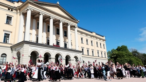 Children parade in front of the Royal Palace in Oslo as part of the traditional celebration of Norwegian Constitution Day
