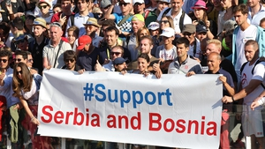 Serbian tennis player Novak Djokovic poses with a banner asking for support for flood victims after his semi-final match at the Italian Open