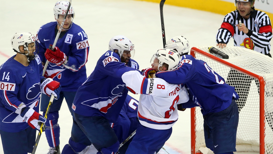 French and Norwegian players scuffle during the Ice Hockey World Championships in Belarus