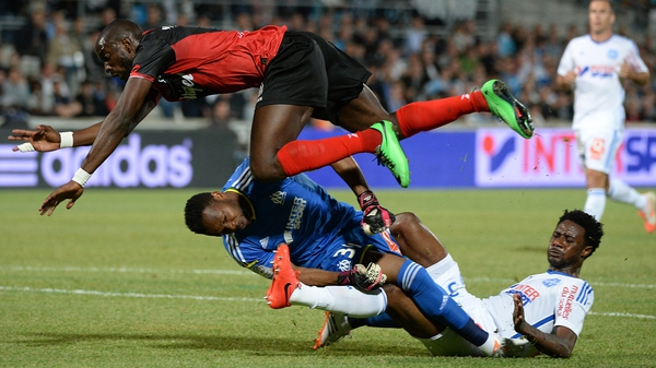 Guingamp striker Mustapha Yatabare collides with Marseille keeper Steve Mandanda