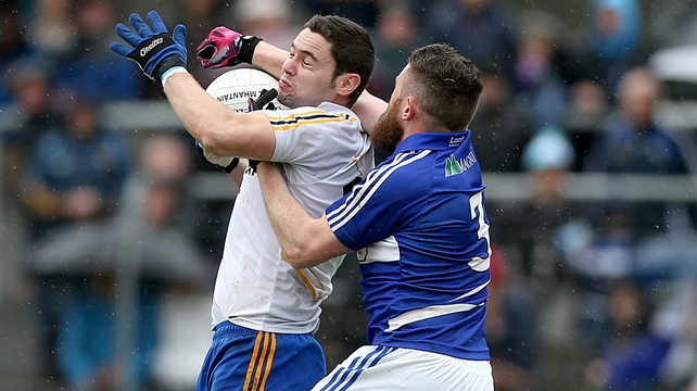 Seanie Furlong of Wicklow is tackled by Paul Begley of Laois