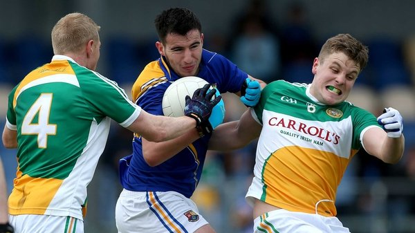 Longford's Mark Hughes battles with Niall Darby and Johnny Moloney of Offaly