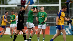 Referee Conor Lane shows a black card to Leitrim's Darren Sweeney during their clash with Roscommon in Dr Hyde Park