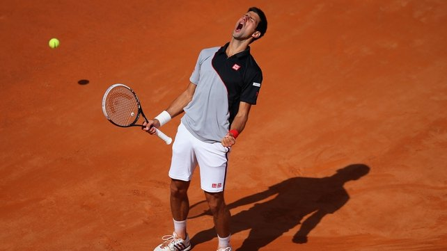 Novak Djokovic celebrates his victory in Rome