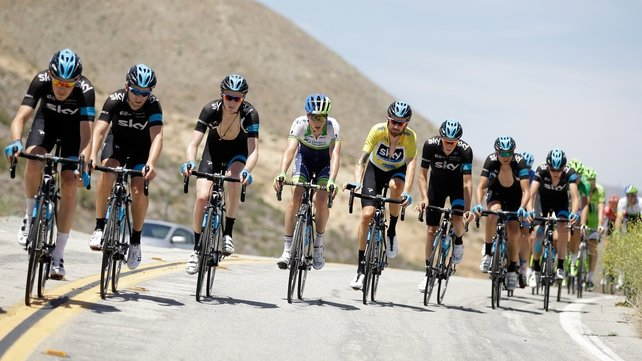 Bradley Wiggins (yellow jersey) in the peloton during the