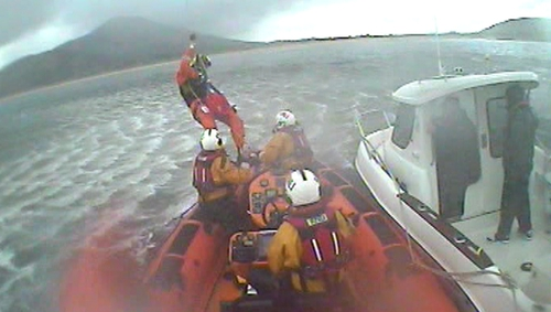 A paramedic was winched onto the lifeboat to assess the fisherman's condition (Pic: Lough Swilly RNLI)