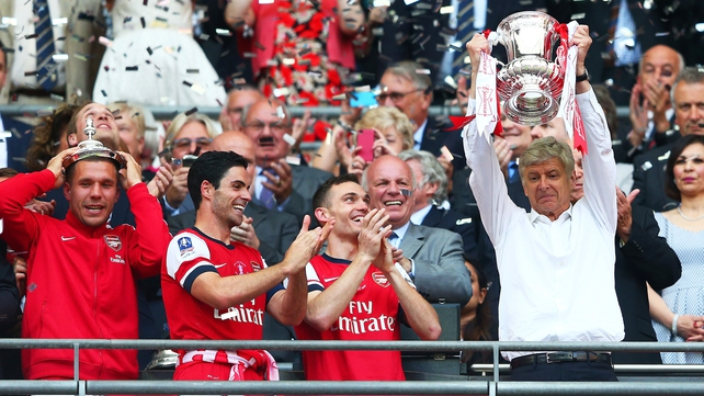 Arsene Wenger lifts the FA Cup, the club's first trophy in nine years