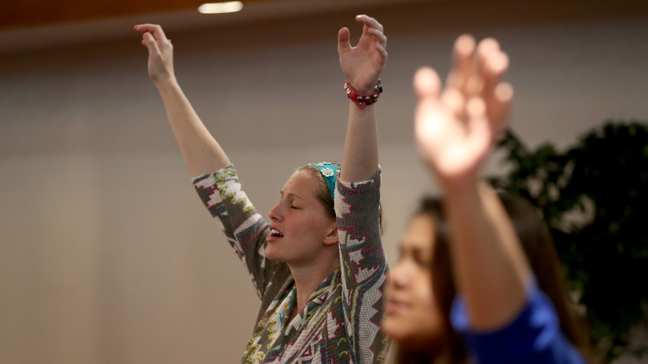 Ashley Nickel prays in a Pentecostal church service in Moore, Oklahoma, before the one-year anniversary of the town being devastated by a tornado