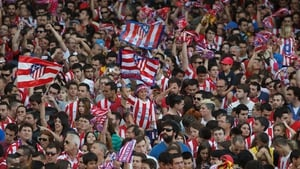 Club Atletico de Madrid fans celebrate as they wait for players after winning their tenth La Liga title at Neptuno Square