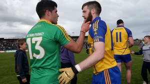 Leitrim's Emlyn Mulligan talks with Cathal Cregg of Roscommon about his facial hair