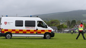 An ambulance comes onto the field in Aughrim after a spectator is taken ill