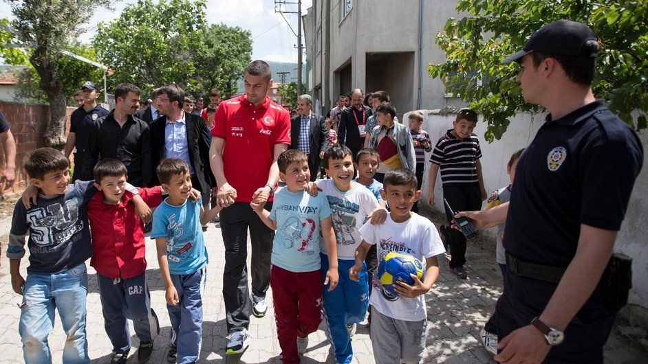 Members of the Turkish national football team visit the village of Avdan to pay their condolences to relatives of miners who lost their lives in an explosion at Soma mine