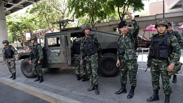 Soldiers secure an area in front of the Royal Thai Police headquarters in Bangkok