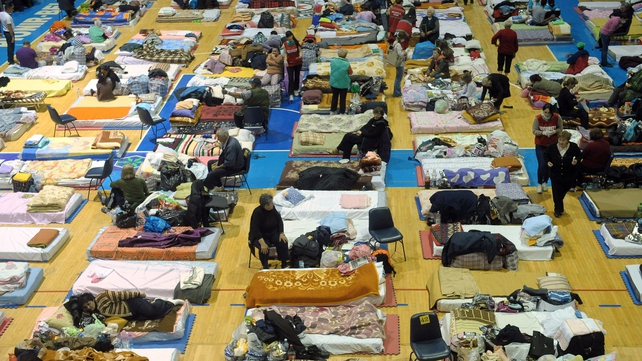 People lie on mattresses in a collective centre for people evacuated from the flooded town of Obrenovac, Serbia