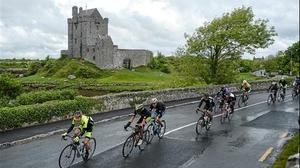 Stage 2: The peloton rides past Dunguaire Castle