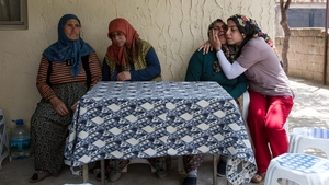 Relatives grieve for a mine worker who died in the explosion at Soma mine, Turkey