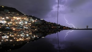 Lightning reflects on the water on the floor of a building under construction in the Haitian capital of Port-au-Prince