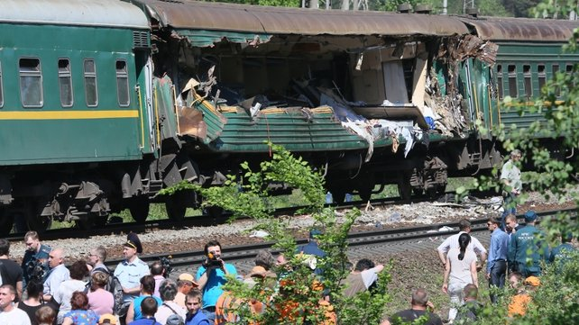 Parts of a freight train derailed and crashed into the passenger train