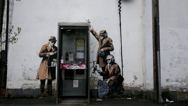 Grafitti, claimed to be by guerilla street artist Banksy, on the side of a house in Cheltenham, UK