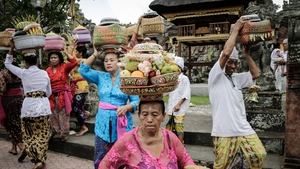 Balinese Hindus carry offerings for god as they celebrate Galungan Day in Gianyar, Bali, Indonesia