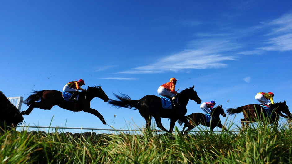 Horses jump the last hurdle in Race 2 of the Sportingbet Park Race Day at Sandown Lakeside in Melbourne, Australia