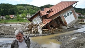 A man stands near a house damaged by flooding and landslides in Krupanj, 130km southwest of Belgrade, Serbia