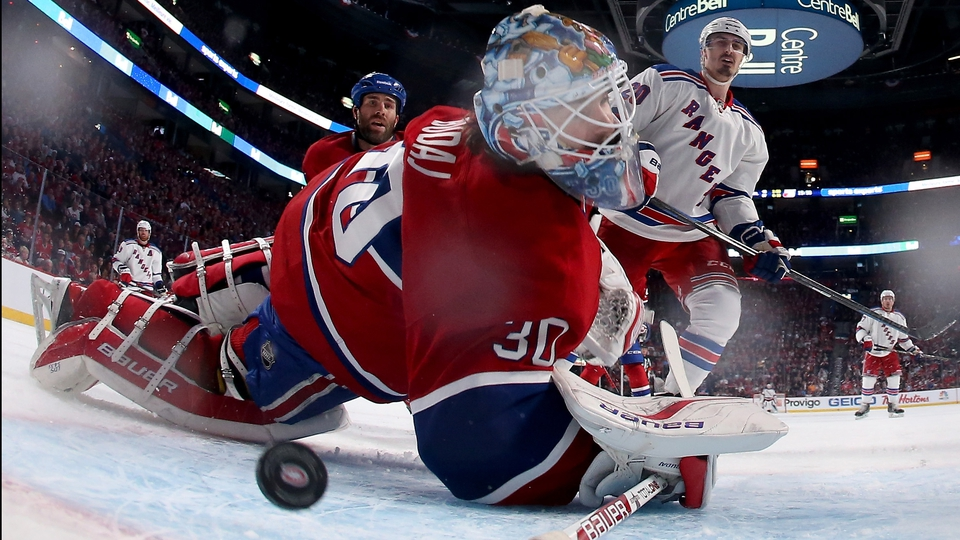 Peter Budaj of the Montreal Canadiens is unable to stop a goal by the New York Rangers in the Eastern Conference Finals of the NHL Stanley Cup in Montreal, Canada
