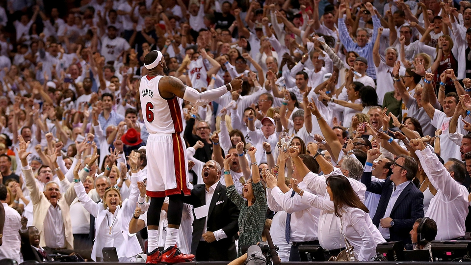 LeBron James of the Miami Heat reacts to winning an Eastern Conference semi-final of the NBA play-offs against the Brooklyn Nets in Miami, Florida