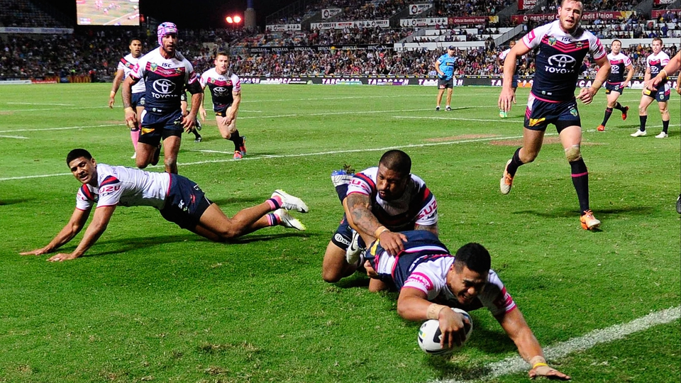 Matthew Wright of the Cowboys scores a try during the round 10 NRL match against the Sydney Roosters in Townsville, Australia