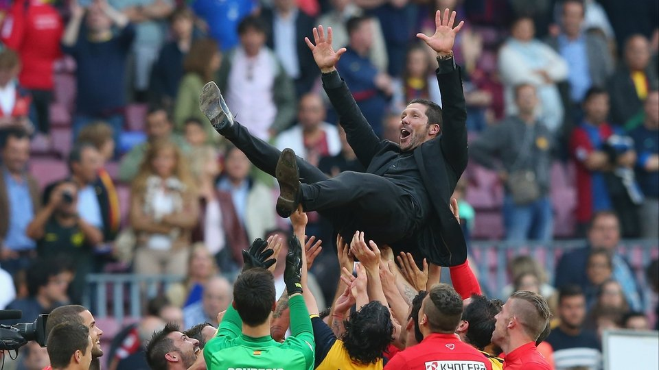 Atletico Madrid manager Diego Simeone is thrown in the air by his players after winning the La Liga after the match against Barcelona at Camp Nou, Spain
