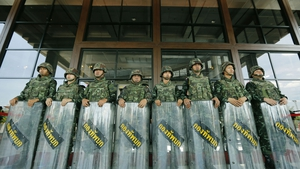 Soldiers stand guard at the Army Club in Bangkok, Thailand