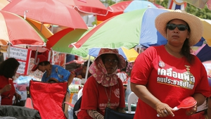 Thai 'red shirt' pro-government protesters rally on the outskirts of Bangkok