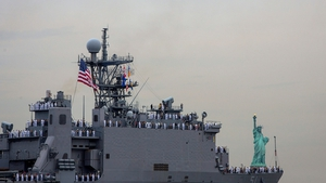 The USS Oak Hill passes the Statue of Liberty as part of Fleet Week in New York City