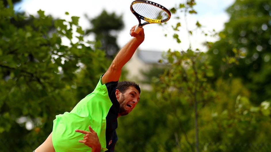 Britain's James Ward serves during his men's qualifying match during previews ahead of the French Open
