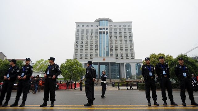 Police stand guard outside the Xianning Intermediate People's Court
