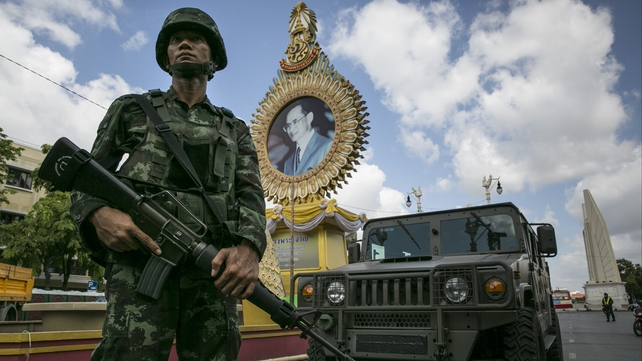 A Thai soldier stands guard in Bangkok in the aftermath of the military seizing power