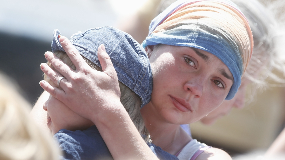 A local woman is overcome with emotion after houses suffered damage from shell explosions during the fighting between pro-Russian militants and the Ukranian Army outside Slaviansk