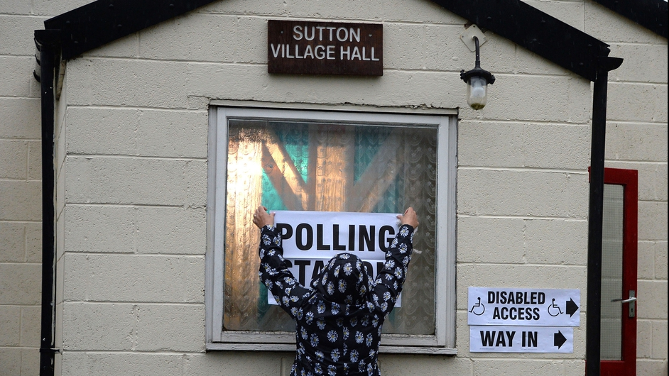 A polling station is prepared before voting in the European Elections at Sutton Hall, outside London