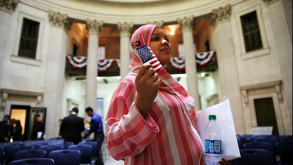 New US citizen Isatu L Bah from Sierra Leone at a naturalisation ceremony at Federal Hall for 75 candidates from 31 countries