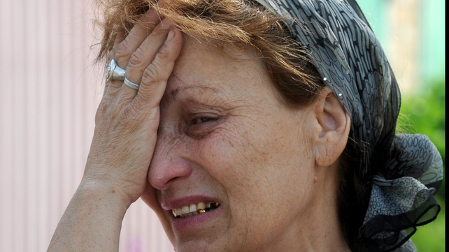 Mizan Mazasheva cries after her house was destroyed during the night combat